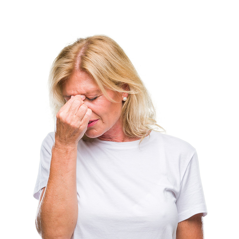 Woman rubbing eyes suffering from dry eye syndrome
